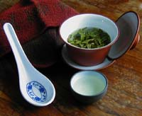 Longjing in a Gaiwan with tasting equipment