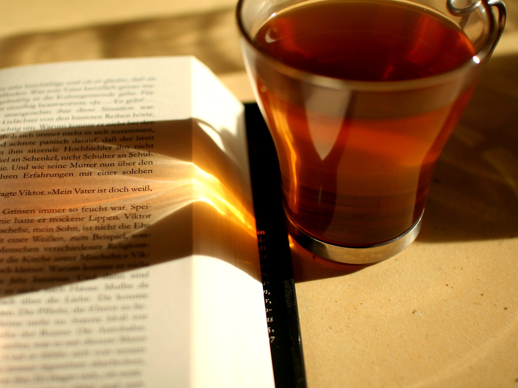 Drinking tea with an open book