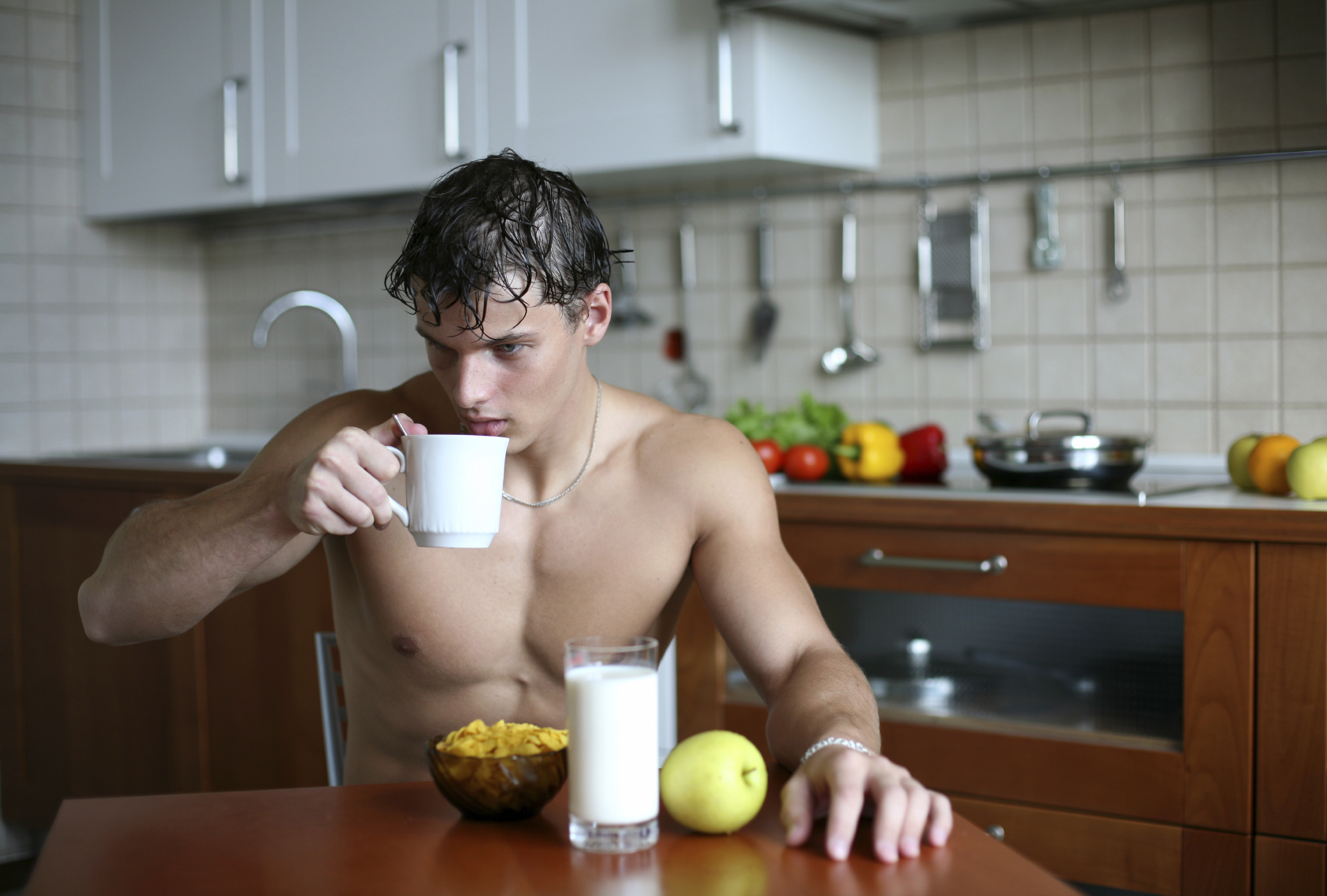 Shirtless male model drinking tea because clearly he lost weight doing so