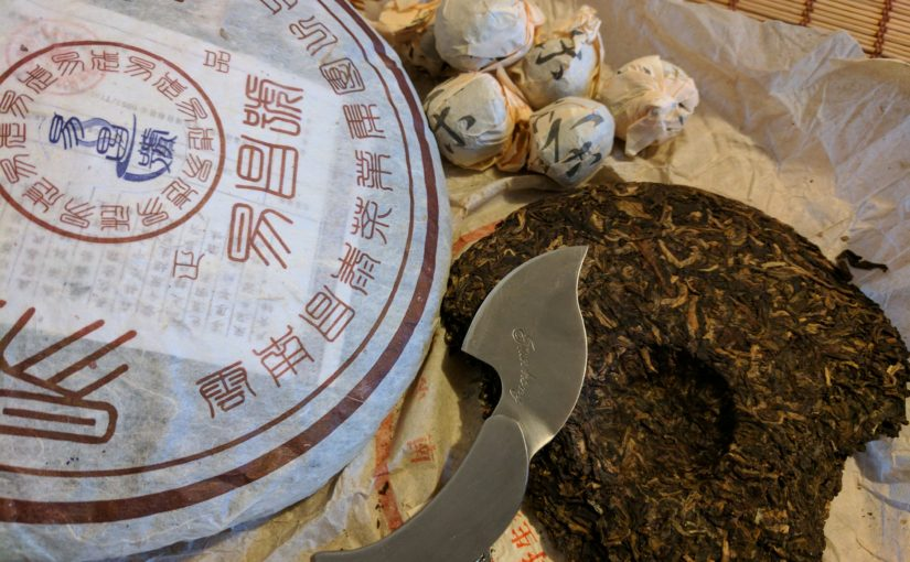 Several different puer cakes and tuocha, as well as a puer knife